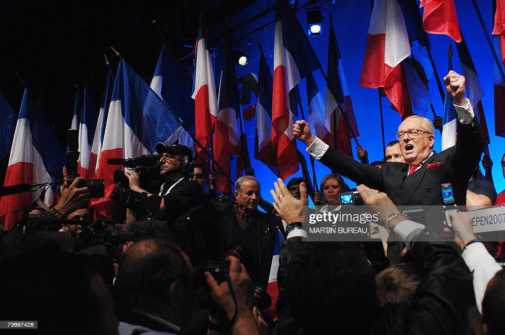 France's far-right Front national party's (FN) president and presidential candidate Jean-Marie Le Pen sings the French national anthem at the end of a meeting 25 March 2007 in Toulouse, southern France.