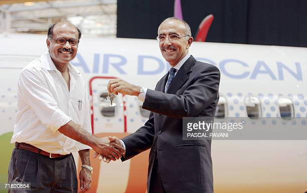 French president of ATR Filippo Bagnato hands over the key of the 700th ATR plane to the Indian president of the low-cost Air Deccan company, Captain...