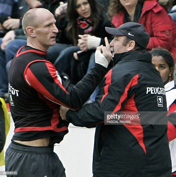 Toulouse's Gareth Thomas gestures angrily at Ulster's supporters next to Toulouse's assistant coach Serge Lairle during the European cup rugby union...