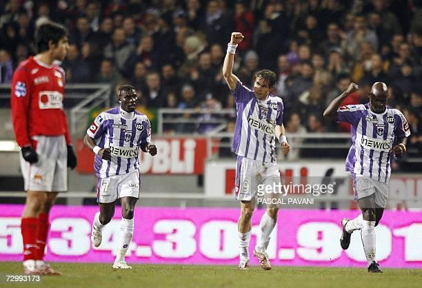 Toulouse's swedish forward Johan Elmander and Cameroonian midfielder Achille Emana celebrates after scoring a goal as Lyon's Brazilian midfielder...