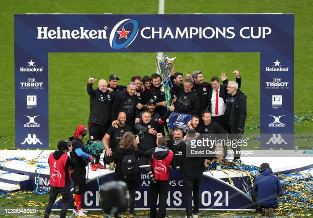 Toulouse head coach Ugo Mola lifts the trophy with coaching staff after the final whistle during the Heineken Champions Cup final match at Twickenham...