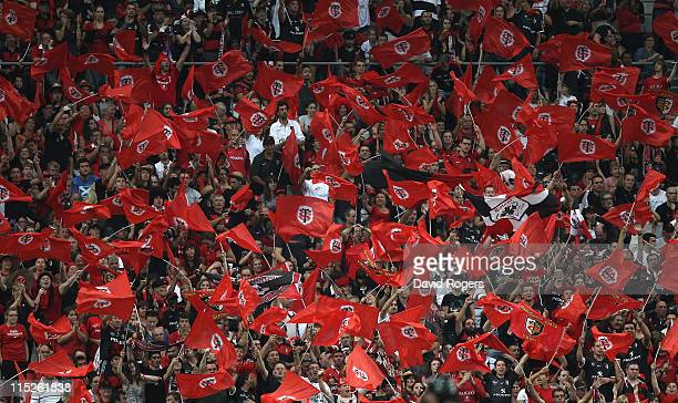 Toulouse supporters celebrate their victory during the French Top 14 Final between Montpellier and Toulouse at Stade de France on June 4 2011 in...