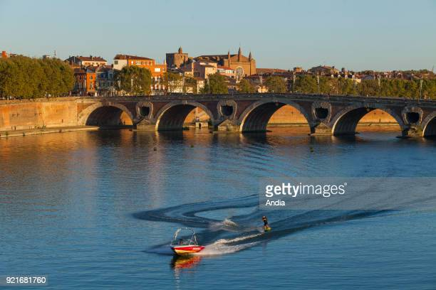 water skiing on the River Garonne with the 'Pont Neuf' bridge and the city in the background