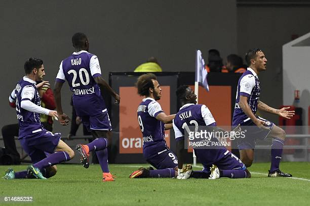 Toulouse's Argentinian midfielder Oscar Trejo celebrates with teammates after scoring a goal during the French L1 football match Toulouse vs Monaco...