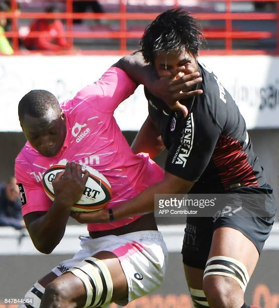 Toulouse's Australian flanker Talalelei Gray vies with Stade Francais French number eight Segou Macalou during the French Top 14 rugby union match...