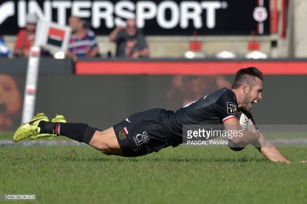 Toulouse's Australian flyhalf Zack Holmes scores a try during the French Top 14 Rugby Union match between Toulouse and La Rochelle on September 8...