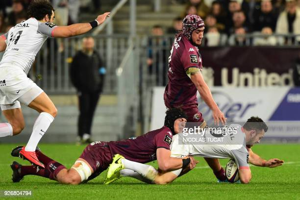 Toulouse's Australian flyhalf Zack Holmes vies with BordeauxBegles players during the French Top 14 rugby union match between BordeauxBegles and...