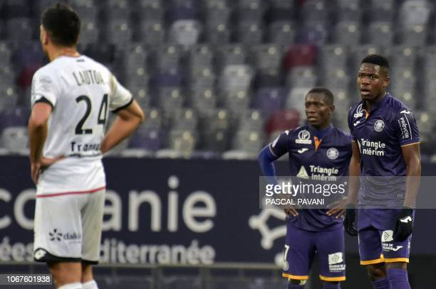 Toulouse's Belgian forward Aaron Leya Iseka and Toulouse's Ivorian forward MaxAlain Gradel look on after scoring a goal during the French L1 football...