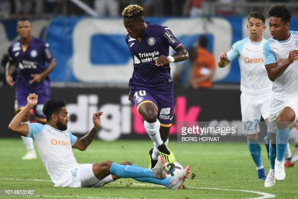 Toulouse's Belgian forward Aaron Leya Iseka vies for the ball with Olympique de Marseille's French defender Jordan Amavi during the French L1...