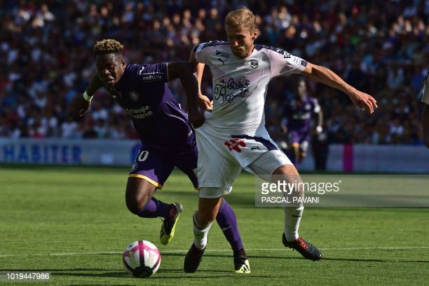 Toulouse's Belgian forward Aaron Leya Iseka vies with Bordeaux's Polish defender Igor Lewczuk during the French L1 football match Toulouse vs...