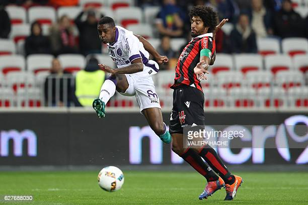 Toulouse's Brazilian midfielder Somalia vies with Nice's Brazilian defender Dante during the French L1 football match Nice vs Toulouse on December 4...