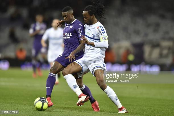 Toulouse's Brazilian midfielder Somalia vies with Strasbourg's French defender Bakary Kone during the French L1 football match between Toulouse and...