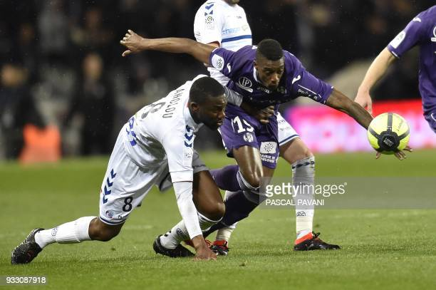 Toulouse's Brazilian midfielder Somalia vies with Strasbourg's Ivorian defender JeanEudes Aholou during the French L1 football match between Toulouse...