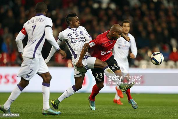 Toulouse's BrazilianCmidfielder Somalia vies for the ball with Guingamp's French forward Jimmy Briand during the French L1 football match between...