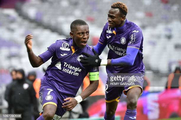Toulouse's captain Max Gradel celebrates after scoring a goal next to teammate Issiaga Sylla during the French L1 football match Toulouse vs Reims on...