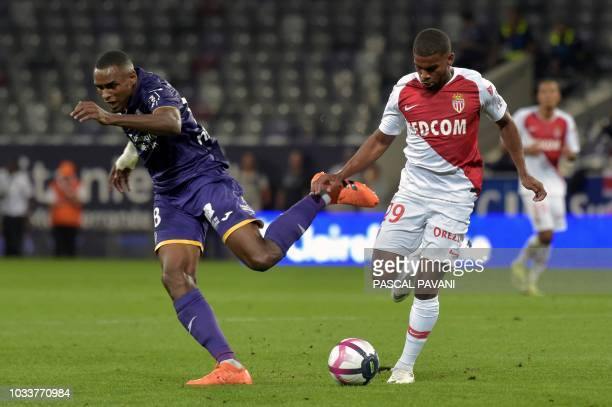 Toulouse's CapVerdean defender Steven Fortes vies with Monaco's French forward Samuel Grandsir during the French L1 football match between Toulouse...