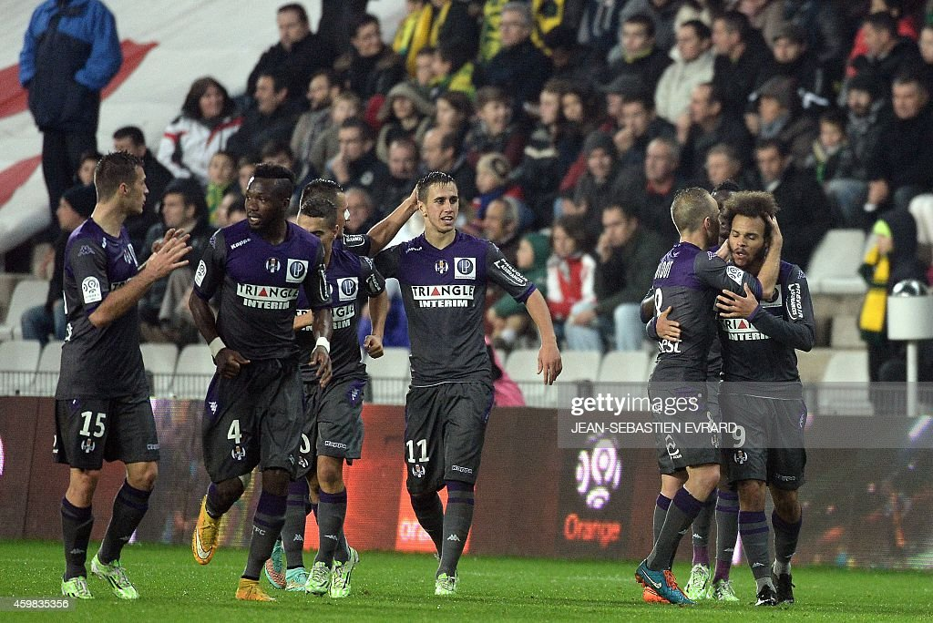 Toulouse's Danish forward Martin Braithwaite (R) celebrates with his teammates after scoring a goal during the French L1 football match between Nantes (FCN) and Toulouse (TFC) on December 2, 2014 at the Beaujoire stadium in Nantes, western France.
