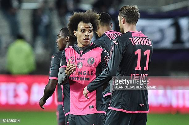 Toulouse's Danish forward Martin Braithwaite is congratulated by his teammate Swedish forward Ola Toivonen after scoring a goal during the French L1...