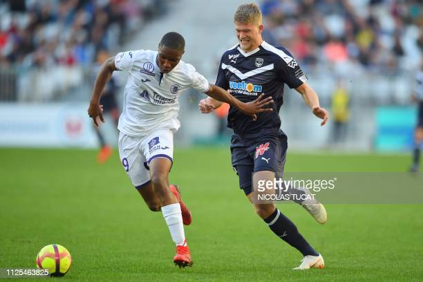 Toulouse's defender Bafode Diakite vies with Bordeaux's Danish forward Andreas Cornelius during the French L1 football match between Bordeaux and...