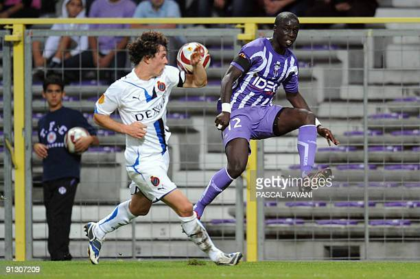 Toulouse's defender Dany M'Bengue vies with Bruge's Karec Geraerts during the UEFA Europa League football match Toulouse vs Bruges on October 01 2009...