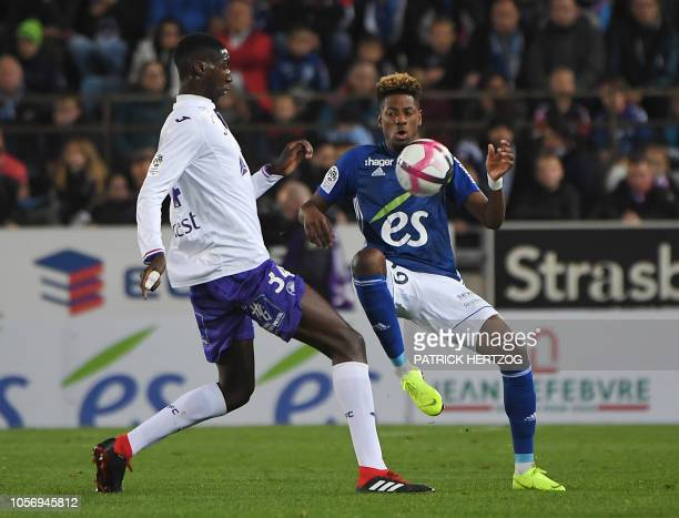 Toulouse's defender Kalidou Sidibe vies with Strasbourg's Cape Verdian forward Nuno Da Costa during the French Ligue 1 football match between...