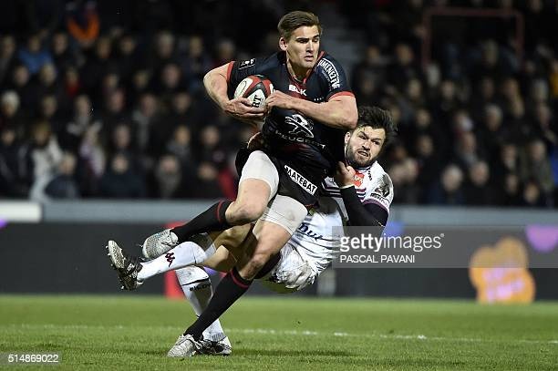 Toulouse's English flyhalf Toby Flood vies with BordeauxBegles' Australian wing Adam AshleyCooper during the French Top 14 rugby union match Toulouse...