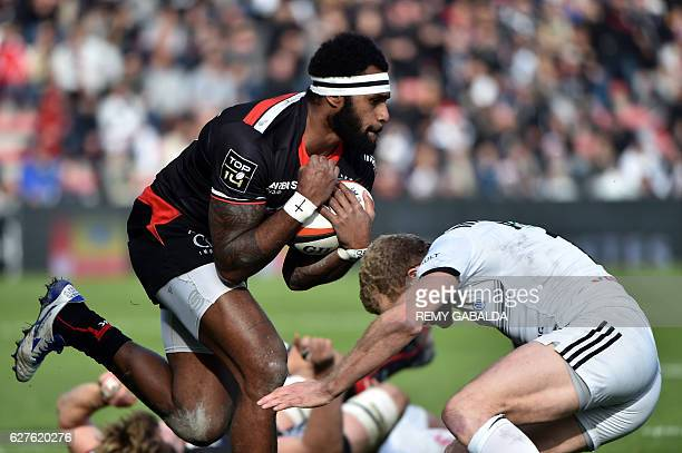 Toulouse's Fidji winger Semi Kunatani runs with the ball during the French Top 14 rugby match between Stade Toulousain and Brive on December 4 2016...