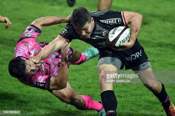 Toulouse's fly half Antoine Dupont runs with the ball during the French Top 14 rugby union match between Stade Toulousain and Stade Français on...