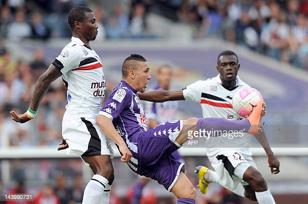 Toulouse's forward Adrien Regattin battles for the ball vies Nice's Franck Dja Djedje during the French L1 football match Toulouse vs Nice on May 7...