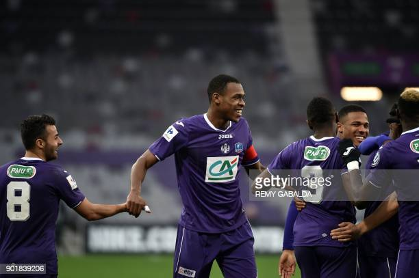 Toulouse's forward Do Rosario Wergiton celebrates with teammates after scoring during the French cup football match Toulouse vs Nice at The Municipal...