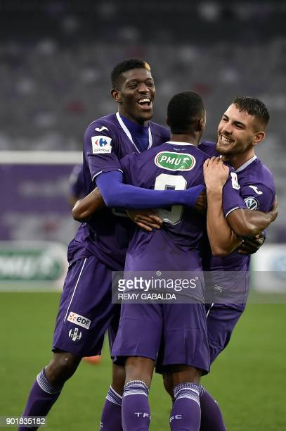 Toulouse's forward Do Rosario Wergiton celebrates with teammates Andy Delort and Ibrahim Sangare after scoring during the French cup football match...