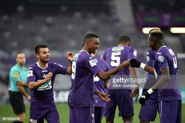 Toulouse's forward Do Rosario Wergiton celebrates with teammates including Issiaga Sylla after scoring during the French cup football match Toulouse...
