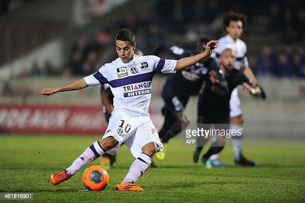 Toulouse's forward Wissam Ben Yedder shoots a penalty kick during the French L1 football match Girondins de Bordeaux vs Toulouse on January 11 2014...