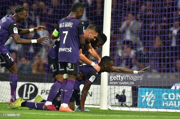 Toulouse's forward Yaya Sanogo celebrates after scoring a goal during the French L1 football match between Toulouse and Lille at the Municipal...