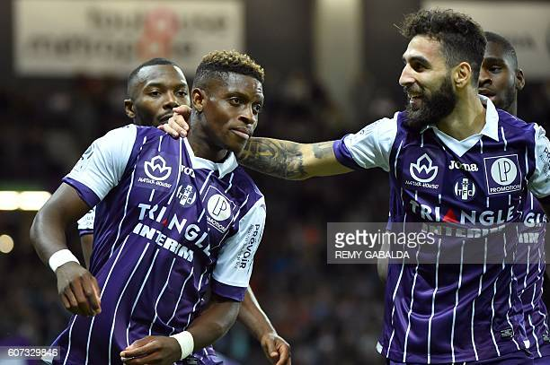 Toulouse's forwards Jakub Durmaz celebrates with Toulouse's defender Moubandje Jacques after scoring a goal during the French L1 football match...