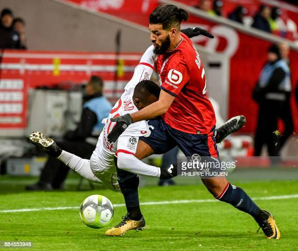 Toulouse's French Burkinabese defender Steeve Yago vies with Lille's French midfielder Fares Bahlouli during the French L1 football match between...
