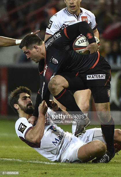 Toulouse's French centre Florian Fritz collapses with BordeauxBegles' Australian wing Adam AshleyCooper during the French Top 14 rugby union match...