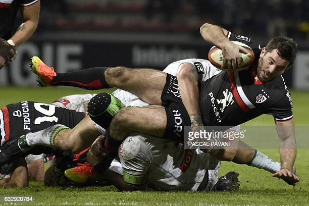 Toulouse's French centre Florian Fritz is tackled by Pau's Samoa lock Masalosalo Tutaia during the French Top 14 rugby union match Toulouse against...