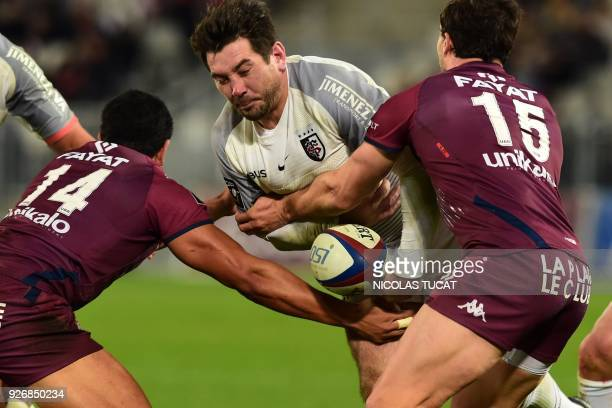 Toulouse's French centre Florian Fritz is tackled during the French Top 14 rugby union match between BordeauxBegles and Toulouse on March 3 2018 at...