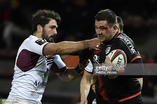 Toulouse's French centre Florian Fritz vies with BordeauxBegles' Australian wing Adam AshleyCooper during the French Top 14 rugby union match...