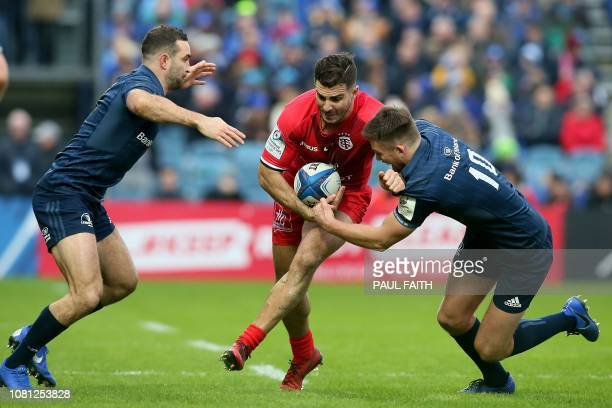 TOPSHOT Toulouse's French centre Sofiane Guitoune is tackled by Leinster's Irish flyhalf Ross Byrne during the European Rugby Champions Cup pool 1...