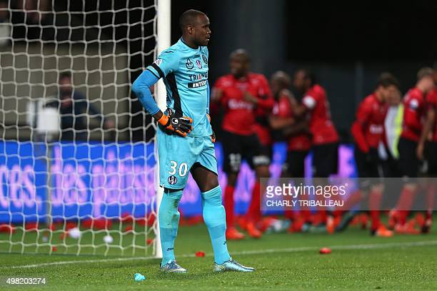 Toulouse's French Comorian goalkeeper Ali Ahamada reacts while Guingamp's players celebrate after scoring a goal French L1 football match between...