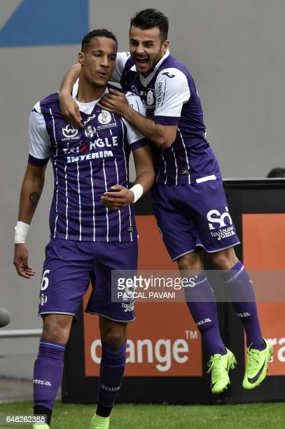 Toulouse's French defender Christopher Jullien celebrates with his teammate forward Andy Delort after scoring a goal during the French L1 football...