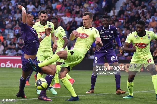 Toulouse's French defender Christopher Jullien vies with Angers' French defender Romain Thomas during the French L1 football match Toulouse against...
