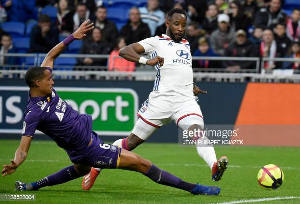 Toulouse's French defender Christopher Jullien vies with Lyon's French forward Moussa Dembele during the French L1 football match Lyon vs Toulouse on...