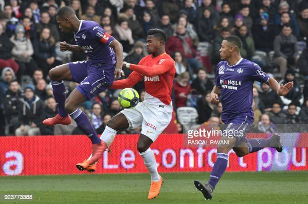 Toulouse's French defender Issa Diop and Toulouse's French defender Kelvin Amian vie with Monaco's Senegalaise forward Keita Balde during the French...
