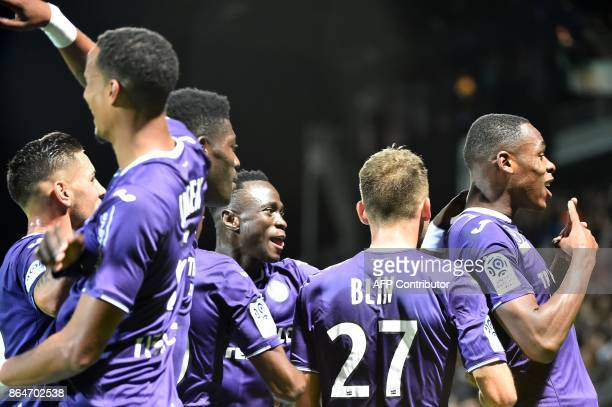 Toulouse's French defender Issa Diop is congratulated after scoring during the French L1 football match between Angers and Toulouse on October 21 in...