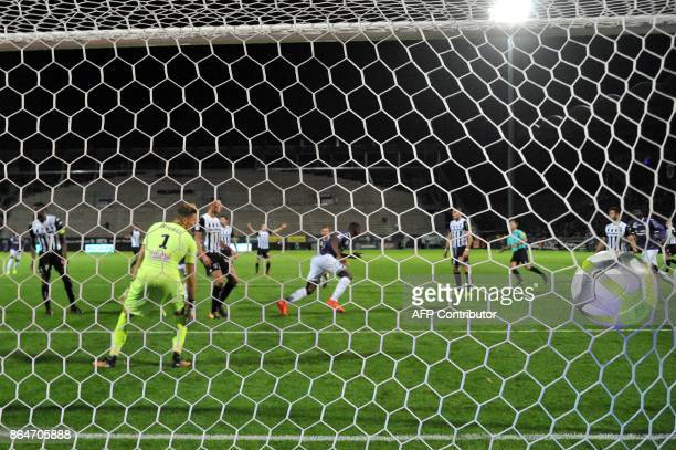 Toulouse's French defender Issa Diop scores Angers' French goalkeeper Mathieu Michel during the French L1 football match between Angers and Toulouse...