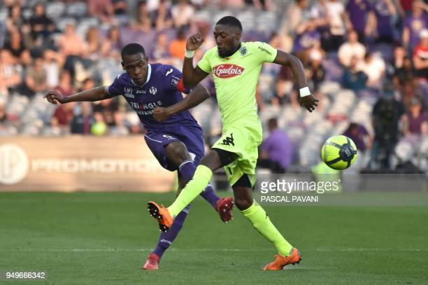 Toulouse's French defender Issa Diop vies with Angers' Cameroonian forward Karl Toko Ekambi during the French L1 football match Toulouse against...