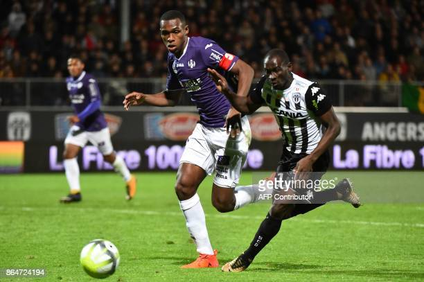Toulouse's French defender Issa Diop vies with Angers' Senegalese midfielder Saliou Ciss during the French L1 football match between Angers and...